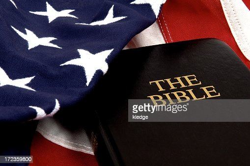 Photo of American flag with a bible