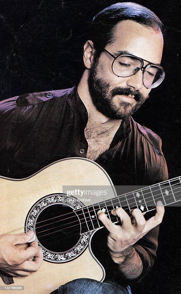 Photo of American musician Al Di Meola performing live on stage with acoustic guitar circa 1975