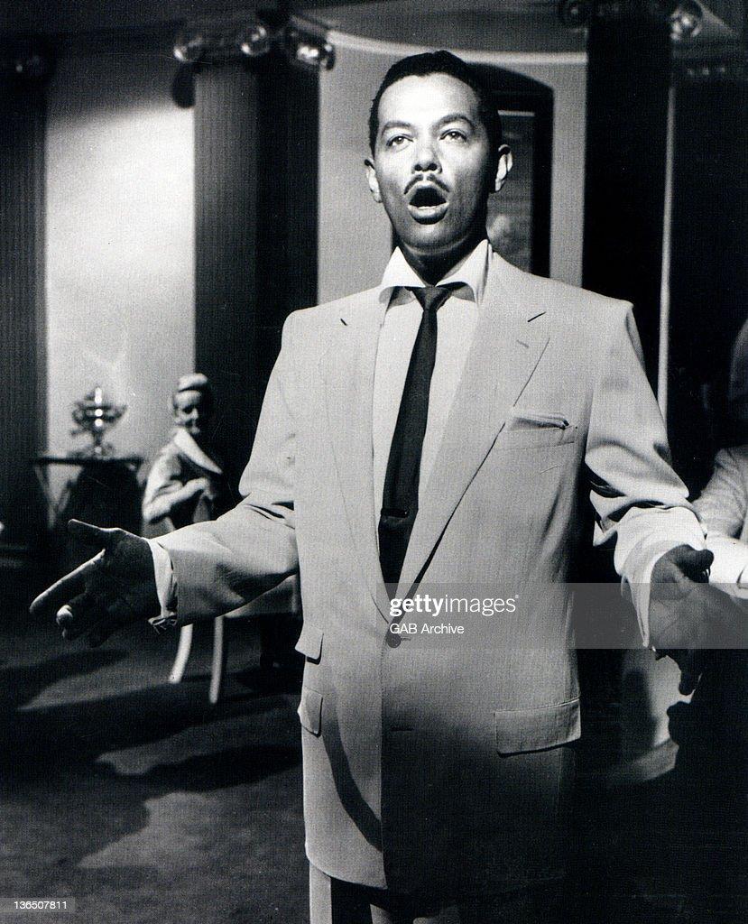 Photo of American singer Billy Eckstine (1914-1993) performing circa 1950.