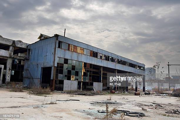 Photo of an abandoned industrial building with broken window
