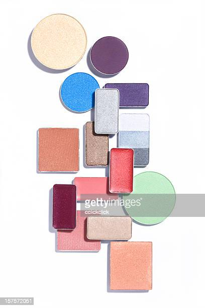 Photo of an abstract arrangement of cosmetics on white