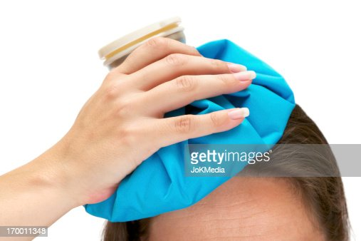 Photo of an aching head with ice bag