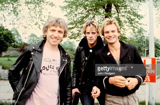 Photo of Andy SUMMERS and Stewart COPELAND and POLICE and STING LR Andy Summers Stewart Copeland Sting posed group shot