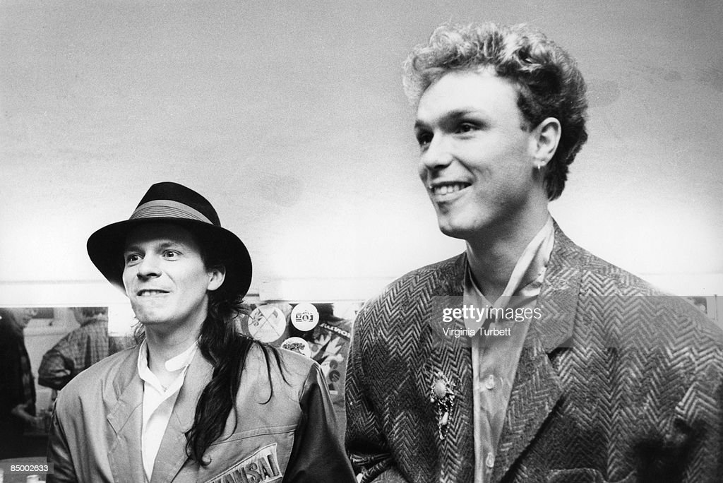 Photo of Andy TAYLOR and SPANDAU BALLET and DURAN DURAN and Gary KEMP; Andy Taylor (Duran Duran) & Gary Kemp (Spandau Ballet) backstage during recording of BBC 'Pop Quiz' TV show