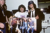 COLISEUM Photo of Angus YOUNG and AC/DC Angus Young backstage with an impersonator