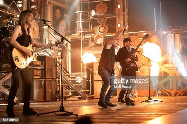 Photo of Angus YOUNG and Malcolm YOUNG and Brian JOHNSON and AC DC and AC/DC LR Malcolm Young Brian Johnson and Angus Young on the set of the video...