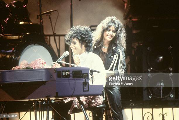 USA Photo of APOLLONIA and PRINCE Prince performing on stage Purple Rain Tour with Apollonia