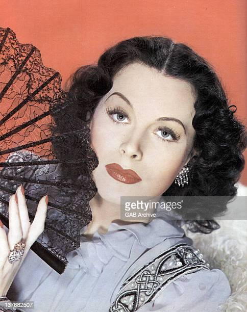 Photo of AustrianAmerican actress Hedy Lamarr posed holding a fan circa 1940