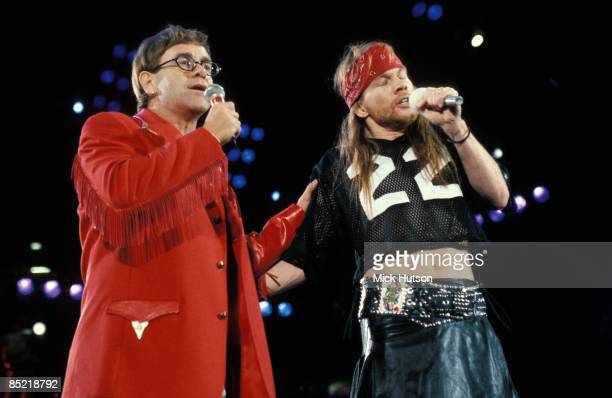 STADIUM Photo of Axl ROSE and Elton JOHN LR Elton John Axl Rose performing live onstage at Freddie Mercury Tribute Concert