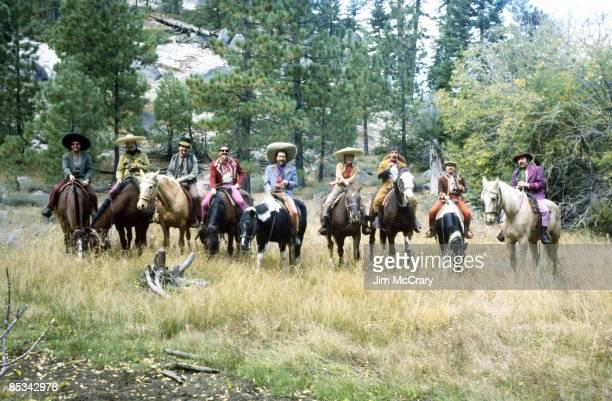 STABLES Photo of BAJA MARIMBA BAND Posed group portrait on horses