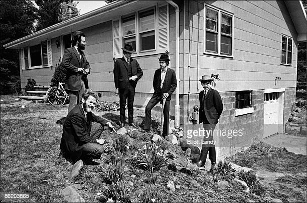 WOODSTOCK Photo of BAND LR Garth Hudson Levon Helm Richard Manuel Robbie Robertson Rick Danko posed group shot outside Big Pink Easter Sunday