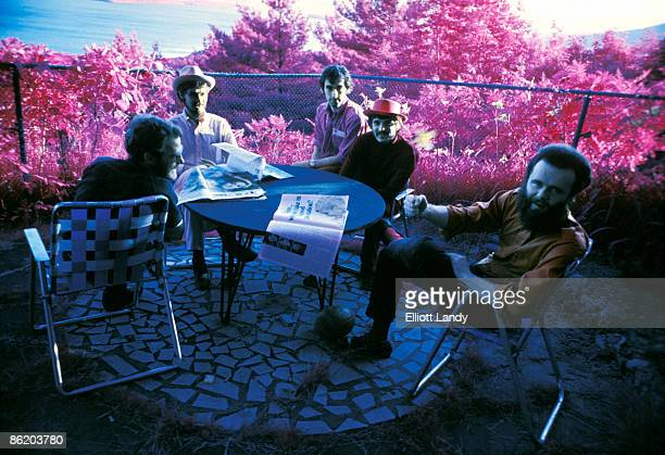 WOODSTOCK Photo of BAND LR Levon Helm Robbie Robertson Richard Manuel Rick Danko Garth Hudson posed group shot outside Richard Garth's house above...