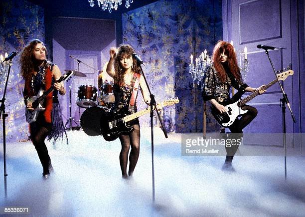 Photo of BANGLES and Vicki PETERSON and Susanna HOFFS and Michelle STEELE LR Vicki Peterson Susanna Hoffs and Michelle Steele performing on a tv show