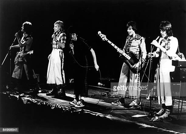 Photo of BAY CITY ROLLERS and Eric FAULKNER and Derek LONGMUIR and Les McKEOWN and Alan LONGMUIR and Stuart WOOD Group performing on stage LR Eric...