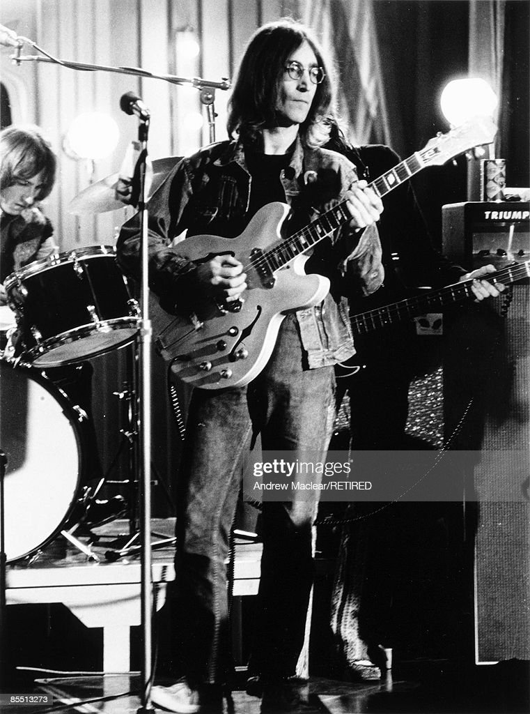 Photo of BEATLES and John LENNON; while in The Beatles, performing live onstage with The Dirty Mac on the set of 'Rock 'n' Roll Circus', playing Epiphone Casino guitar