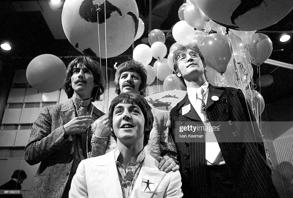 STUDIOS Photo of BEATLES, George Harrison, Paul McCartney, Ringo Starr, John Lennon posed, group shot at press conference before performing All You Need Is Love on world satellite link up