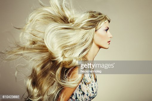 Photo of beautiful woman with magnificent hair : Stock Photo