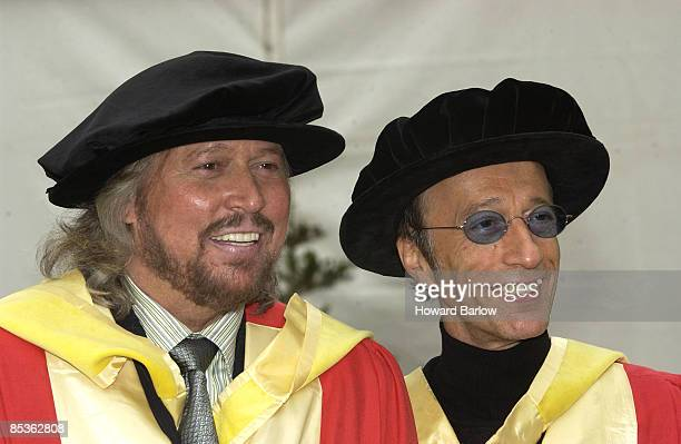 Photo of BEE GEES Accepting honorary music doctorates @ Manchester University