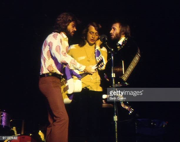 NASHVILLE Photo of BEE GEES and Barry GIBB and Robin GIBB and Maurice GIBB Group performing on stage LR Barry Robin and Maurice Gibb
