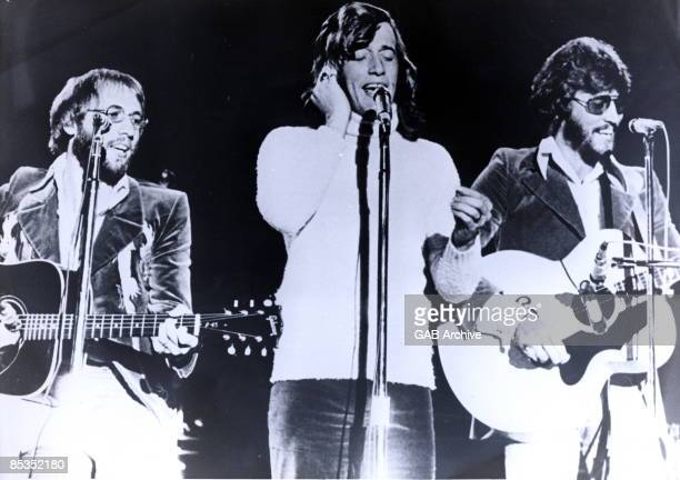 Photo of BEE GEES Performing live on stage LR Maurice Robin and Barry Gibb