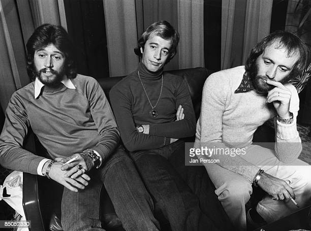 Photo of BEE GEES posed at a press conference in 1975 Left to right Barry Gibb Robin Gibb and Maurice Gibb