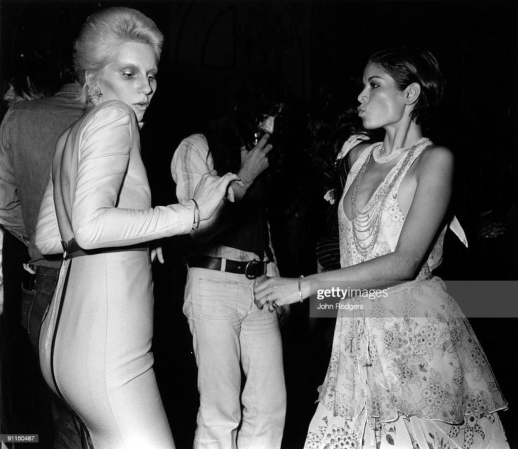 Photo of Bianca JAGGER and Angie BOWIE; Angie Bowie (L) dancing with Bianca Jagger at the Ziggy Stardust retirement party held at the Cafe Royal