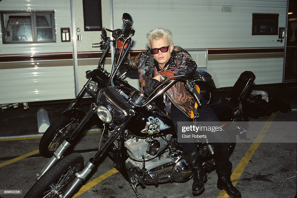 Photo of Billy IDOL; posed, sitting on motorbike