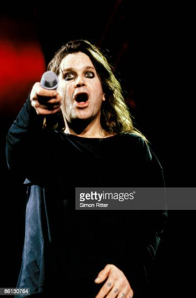 BIRMINGHAM Photo of BLACK SABBATH and Ozzy OSBOURNE Ozzy Osbourne performing on stage pointing microphone