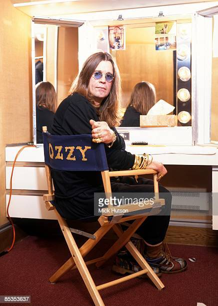 Photo of BLACK SABBATH and Ozzy OSBOURNE Posed portrait of Ozzy Osbourne backstage dressing room mirror director chair