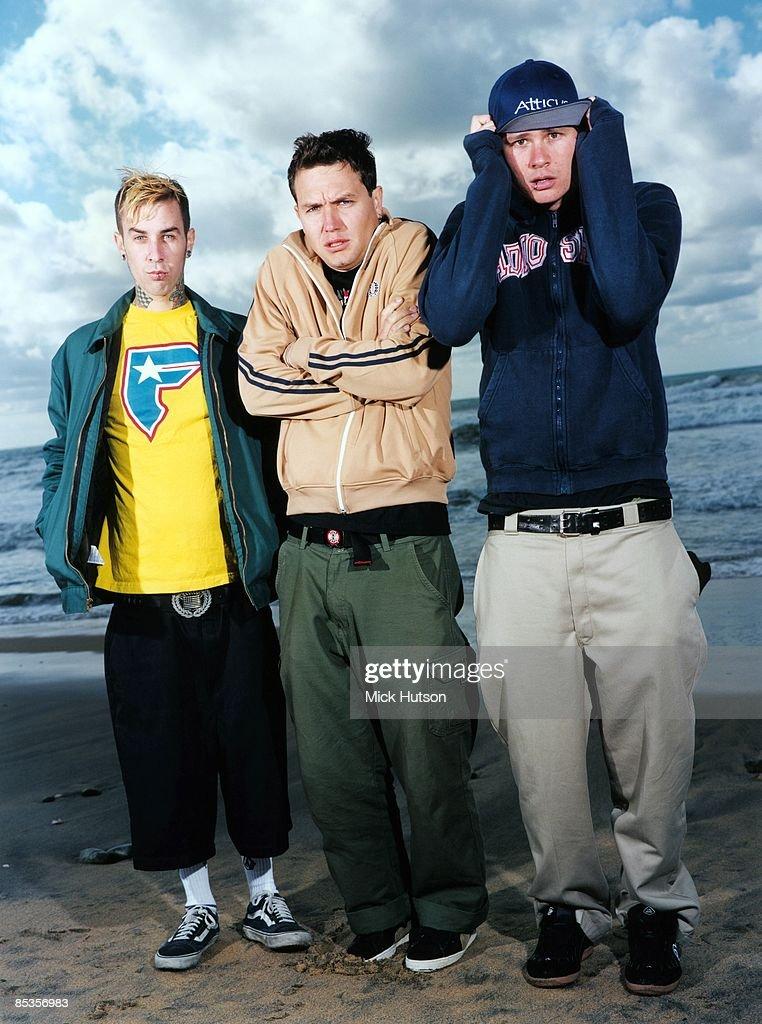 Photo of BLINK 182 and Travis BARKER and Tom DELONGE and Mark HOPPUS Posed group full length portrait LR Travis Barker Tom DeLonge and Mark Hoppus...