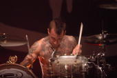 ARENA Photo of BLINK 182 Travis Barker performing on stage
