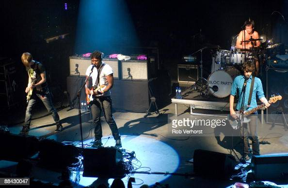 WATT Photo of BLOC PARTY and Russell LISSACK and Kele OKEREKE and Matt TONG and Gordon MOAKES Group performing on stage LR Russell Lissack Kele...