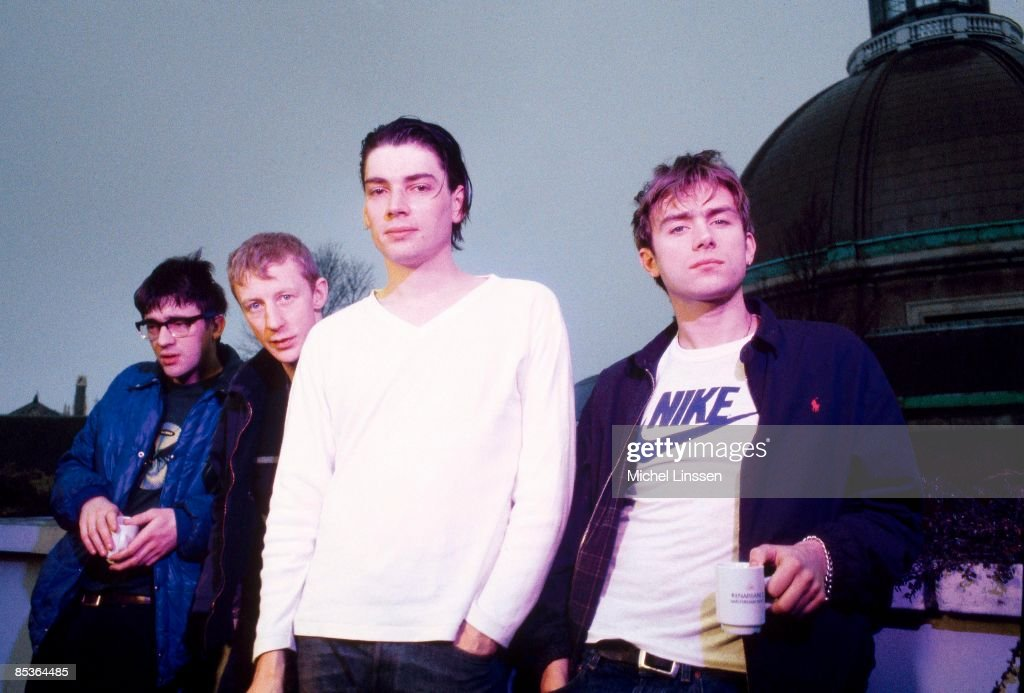 Photo of BLUR and Dave ROWNTREE and Graham COXON and Damon ALBARN and Alex JAMES LR Graham Coxon Dave Rowntree Alex James Damon Albarn posed group...
