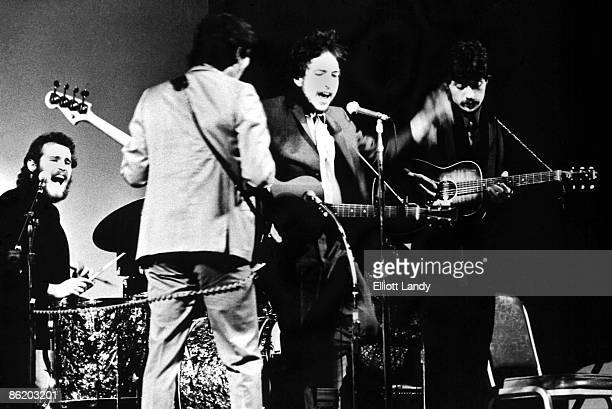 Levon Helm Rick Danko Bob Dylan Robbie Robertson performing live onstage with the Band at Woody Guthrie tribute concert