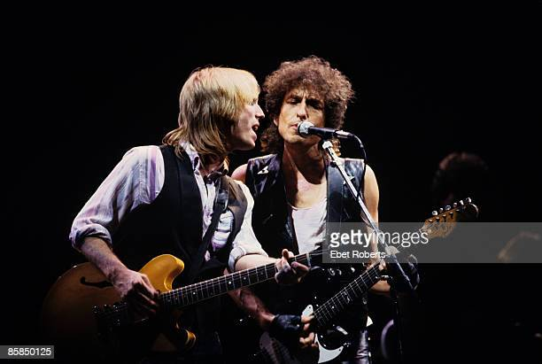 ARENA Photo of Bob DYLAN and Tom PETTY and Tom PETTY The HEARTBREAKERS LR Tom Petty Bob Dylan performing live onstage with Tom Petty and The...