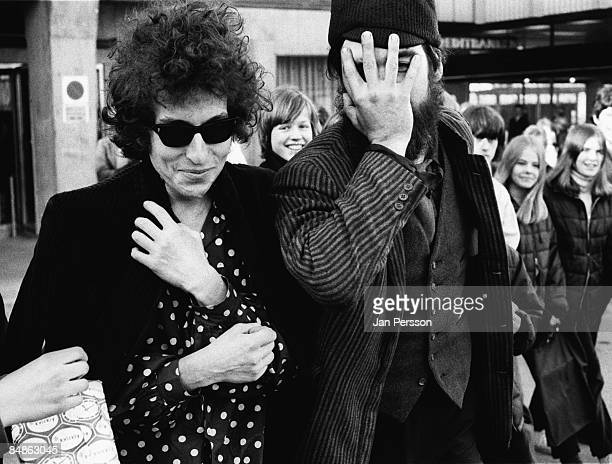 Photo of Bob DYLAN posed smiling wearing sunglasses