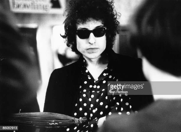 Photo of Bob DYLAN posed wearing sunglasses