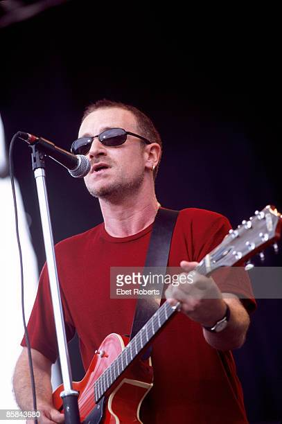 Photo of BONO and U2 Bono performing live onstage at Tibet Freedom Festival during PopMart tour
