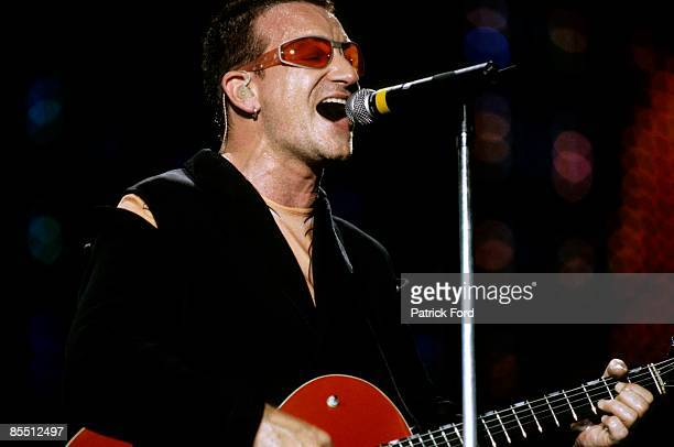 STADIUM Photo of BONO and U2 Bono performing live onstage on PopMart tour