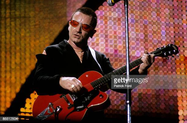 STADIUM Photo of BONO and U2 Bono performing live onstage on PopMart tour playing Gretsch 6119 Chet Atkins Tennessean guitar