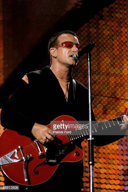 STADIUM Photo of BONO and U2 Bono performing live onstage on PopMart tour playing Gretsch 6119 Chet Atkins Tennessean guitar Bigsby Vibrato