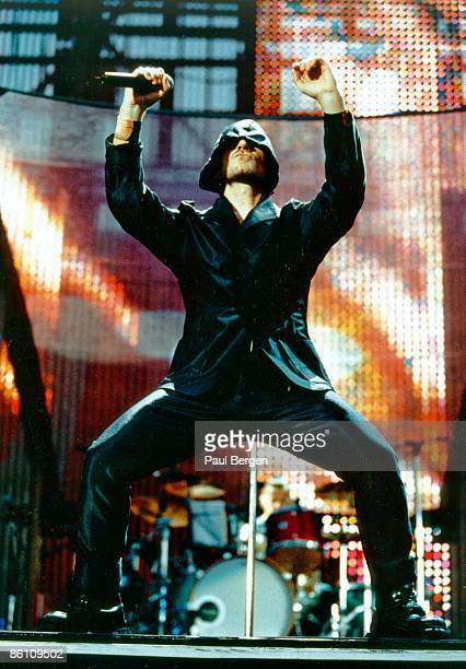 ROTTERDAM Photo of BONO and U2 Bono performing live onstage on PopMart tour