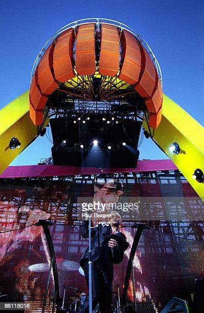 ROTTERDAM Photo of BONO and U2 Bono performing live onstage on the Popmart Tour with stage set and speakers behind