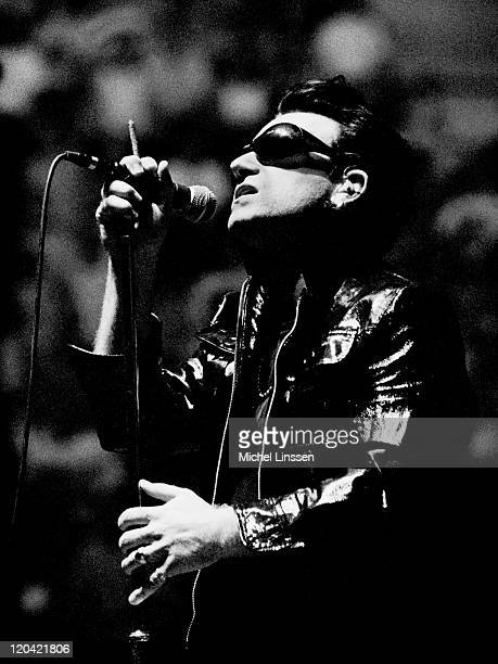 Photo of BONO and U2 Bono performing live onstage on ZOO TV tour at Ahoy in Rotterdam Netherlands on June 15th 1992