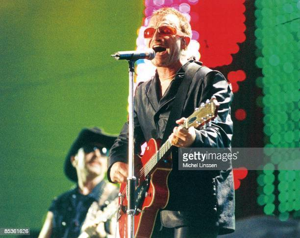 ROTTERDAM Photo of BONO and U2 Bono with The Edge in background performing live onstage on PopMart tour