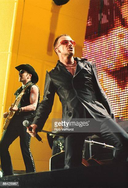 ROTTERDAM Photo of BONO and U2 The Edge and Bono performing live onstage at Feijenoord Stadium on PopMart tour