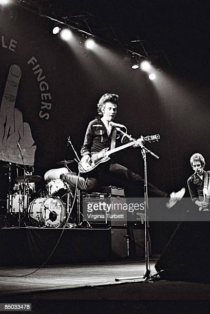 Photo of Brian FALLOON and STIFF LITTLE FINGERS and Ali MCMORDIE and Jake BURNS LR Brian Falloon Jake Burns Ali McMordie