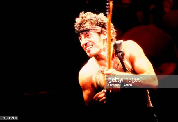 USA Photo of Bruce SPRINGSTEEN performing live onstage on Born In The USA tour wearing bandana