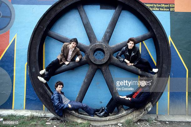 Photo of BUZZCOCKS and Steve DIGGLE and Pete SHELLEY and Steve GARVEY and John MAHER Posed group portrait giant wheel LR Steve Diggle Pete Shelley...