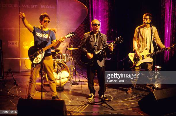 Photo of BUZZCOCKS and Steve DIGGLE and Pete SHELLEY and Tony BARBER LR Steve Diggle Pete Shelley and Tony Barber performing on stage